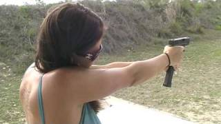 Christina Firing Glock 26 9mm Pistol